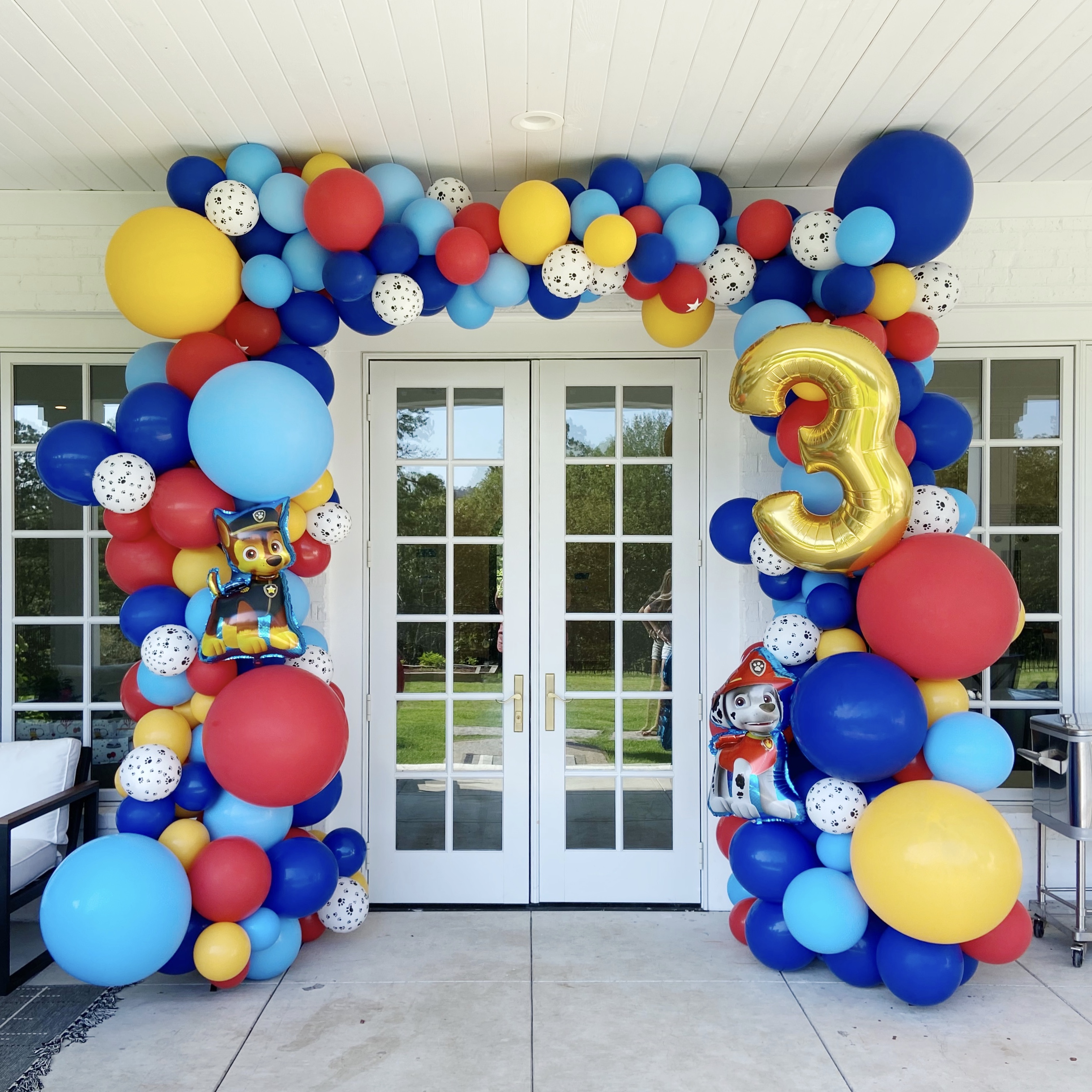 Entryway full balloon arch wrap in Paw Patrol theme by Just Peachy in Little Rock, Arkansas.