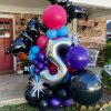 Halloween balloon installation with sparkly bats, silver stars, and black and bright colors by Just Peachy in Little Rock.