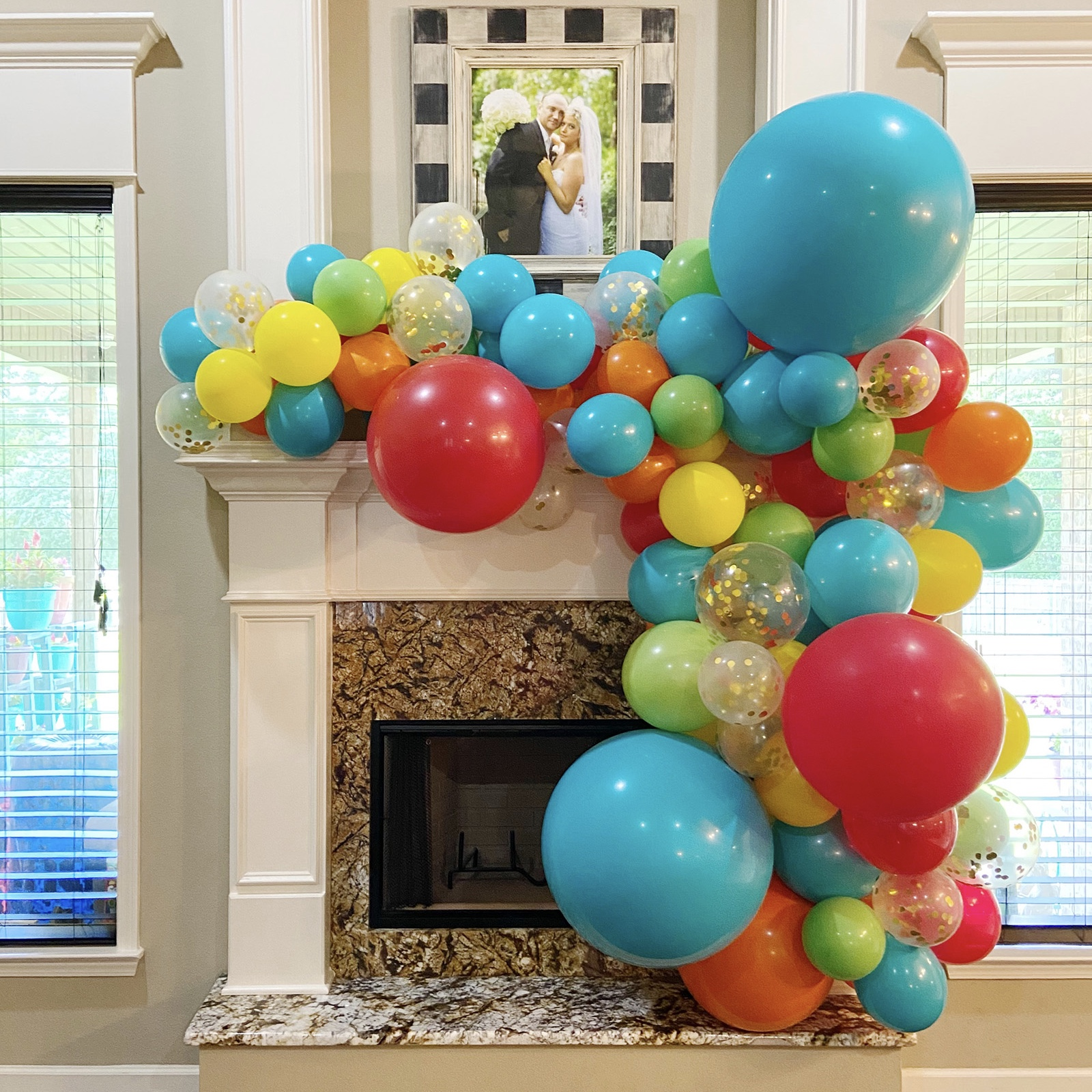 Make a mantle gorgeous with a balloon garland installation like this one for a Benton birthday with confetti balloons from Just Peachy.