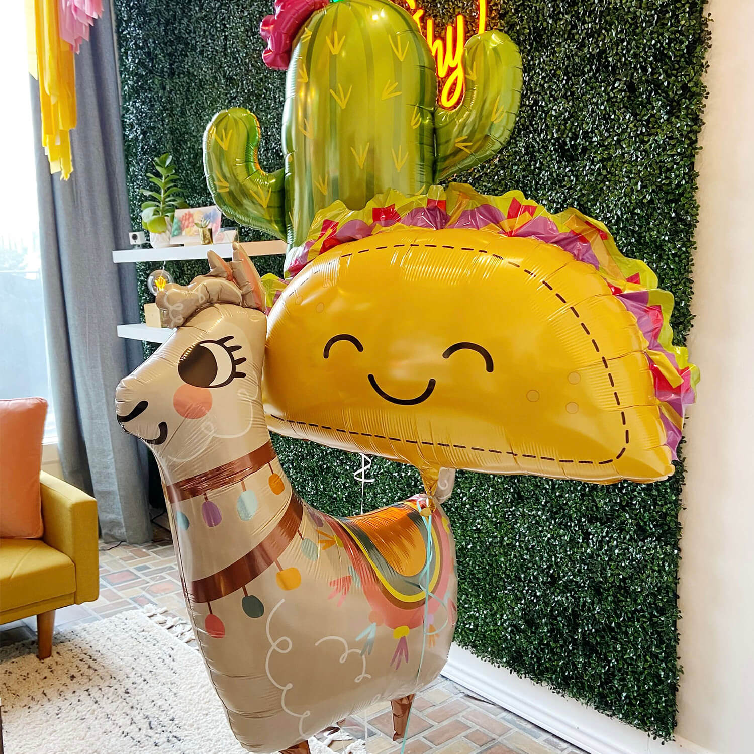 Make someone as happy as a llama with a helium bouquet like this one with giant taco, llama, and cactus balloons from Just Peachy.