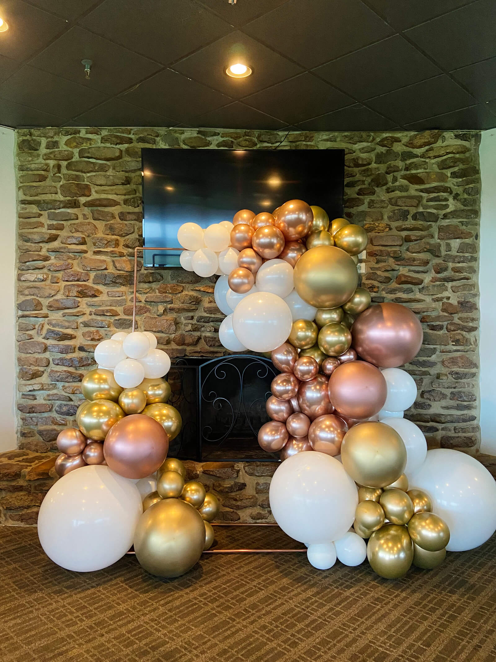 Just Peachy rents backdrops, like this large rectangle copper stand with balloons, for weddings and parties in central Arkansas.