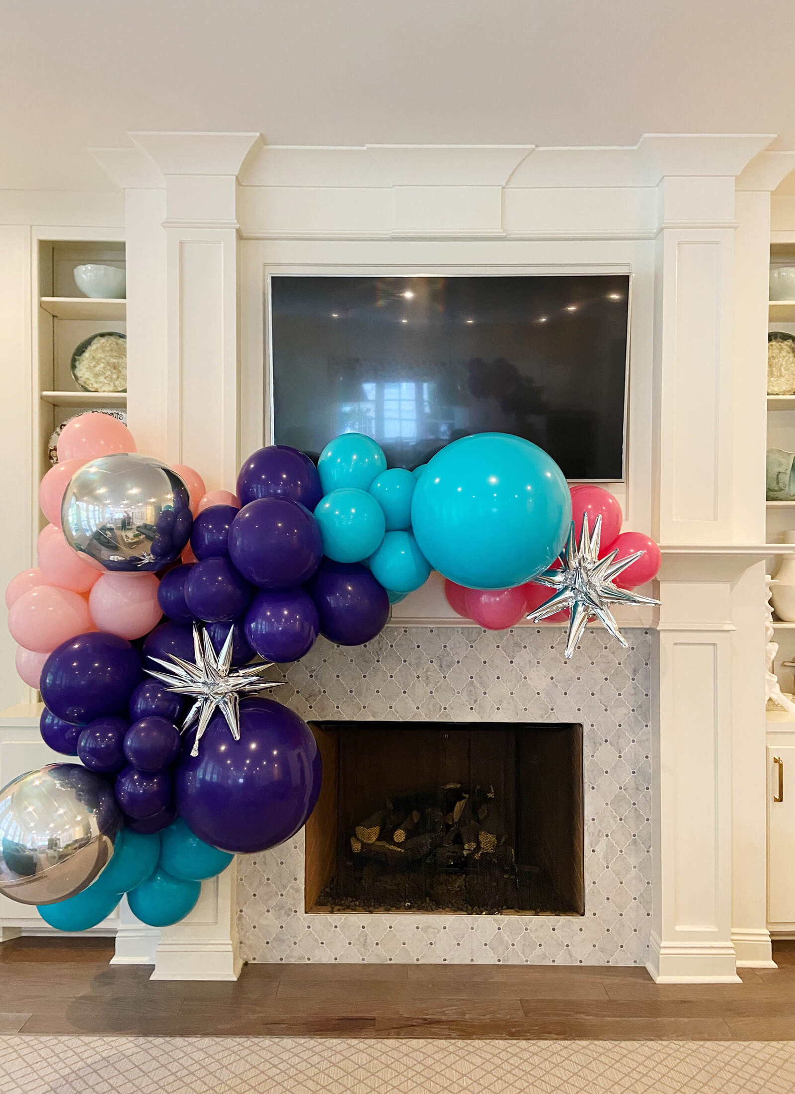 Make a mantle gorgeous with a balloon garland installation like this one for a birthday celebration from Just Peachy.