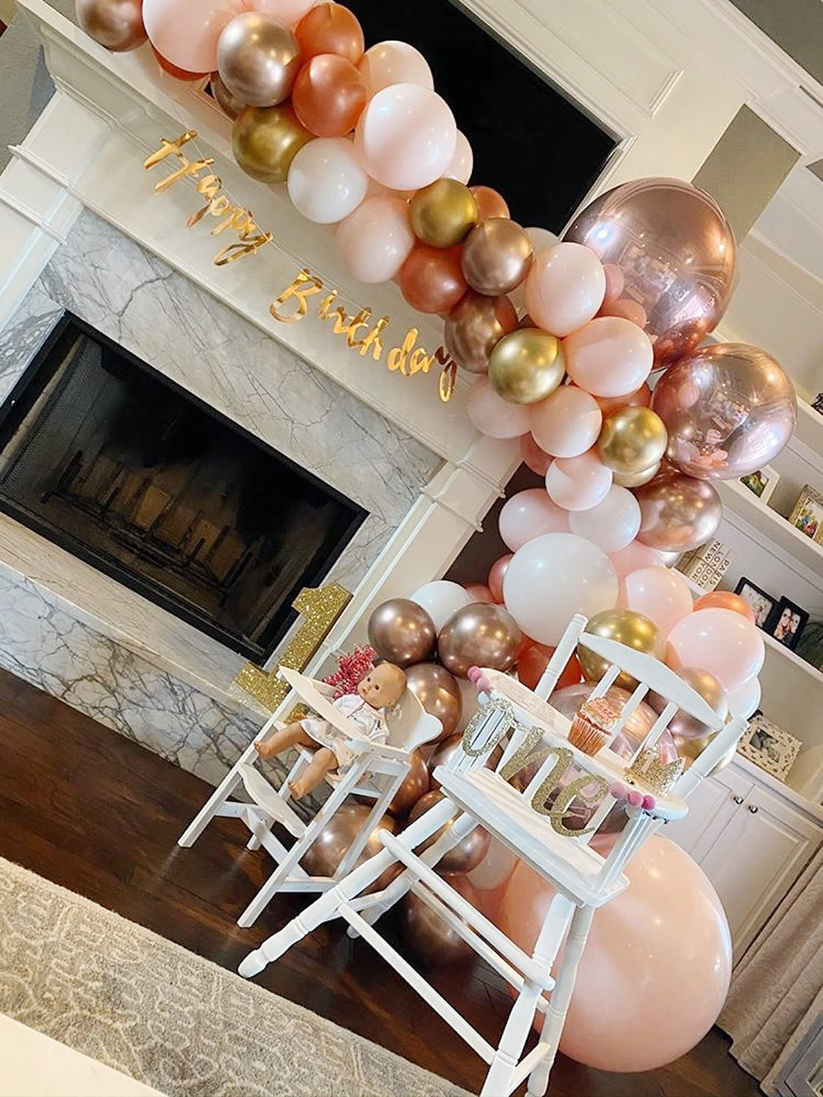 Happy Birthday baby with a beautiful mantle balloon garland hanging from Just Peachy in Little Rock, Arkansas,