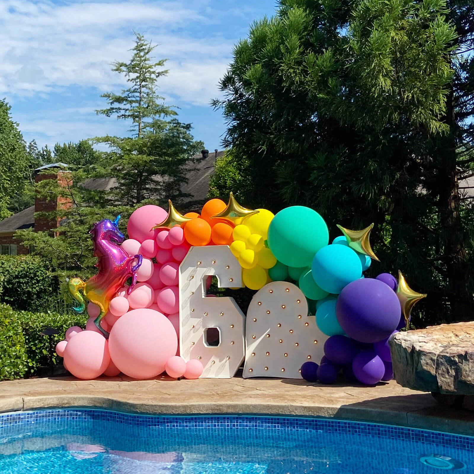 Events by the pool - we love to help with fun birthday party installs like this.