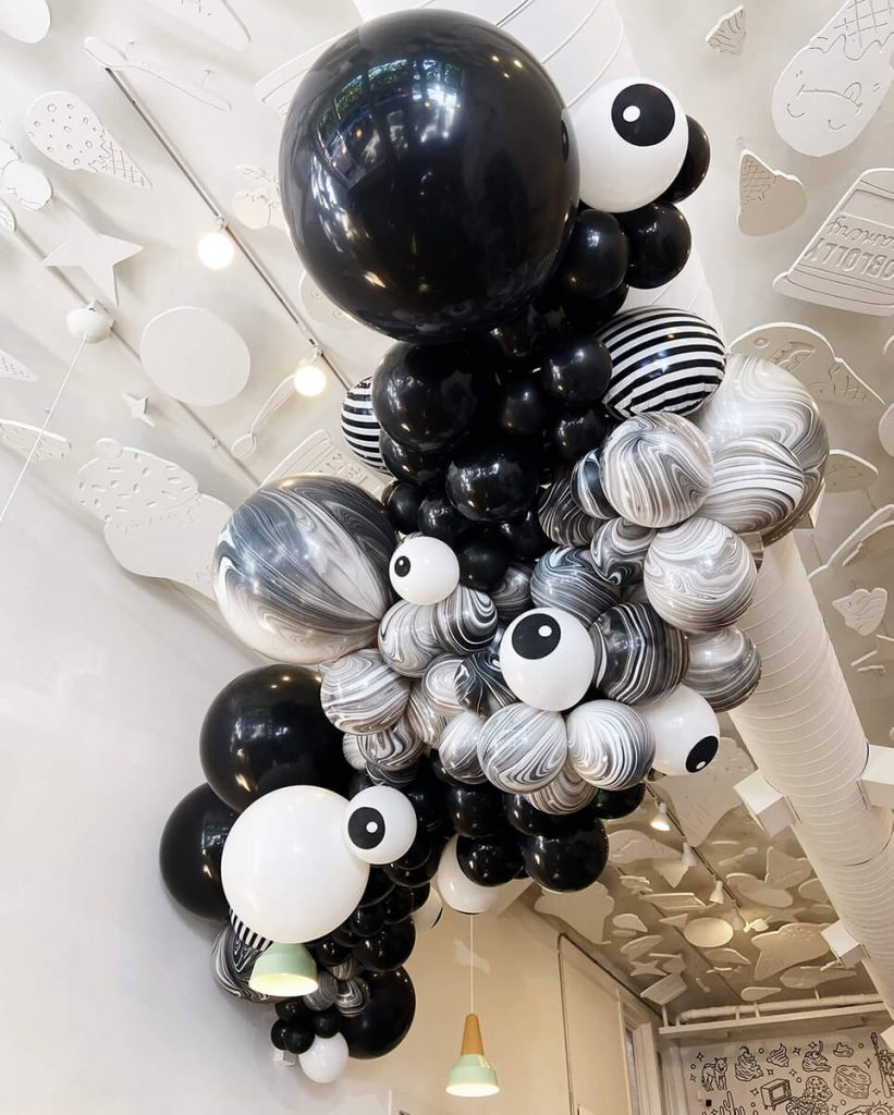 Black and white Halloween balloon ceiling arch by Just Peachy at Loblolly Creamery in Little Rock.