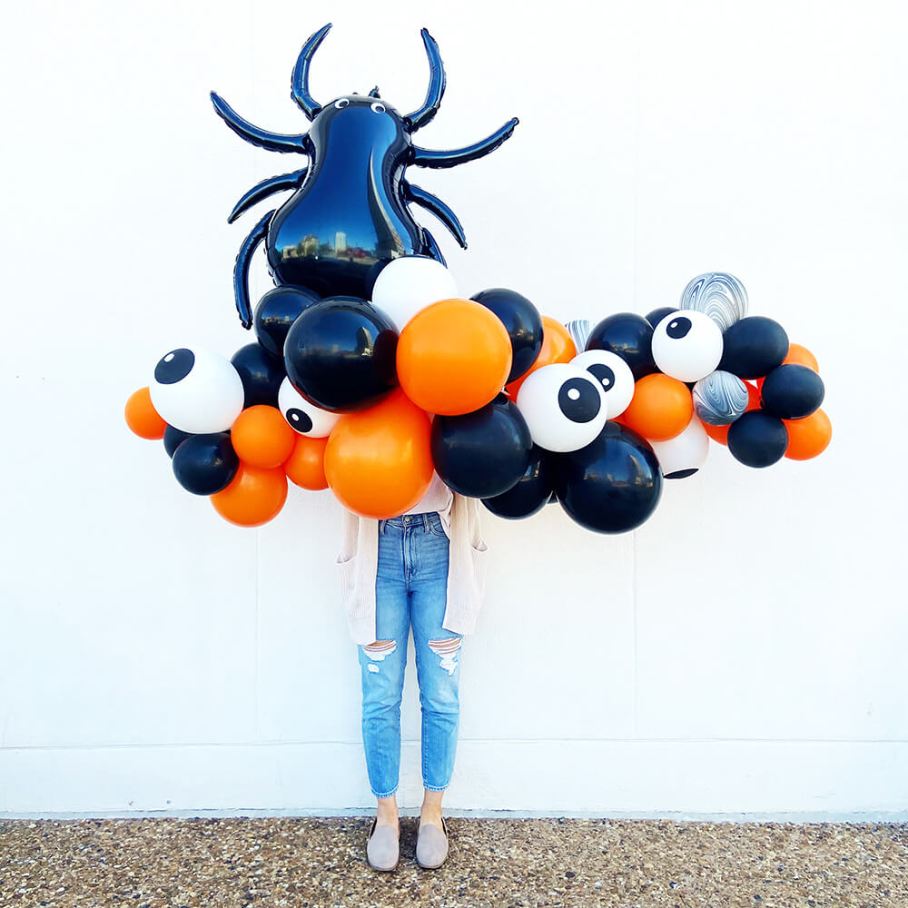Orange, black, agate, and eyeball balloons make a spooky Halloween garland from Just Peachy in Little Rock.