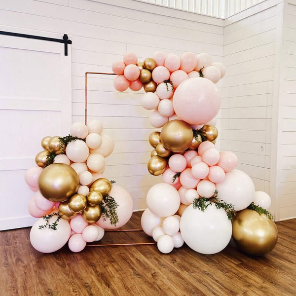 Just Peachy rents backdrops, like this large rectangle copper stand with balloons, for weddings, anniversaries and parties in central Arkansas.