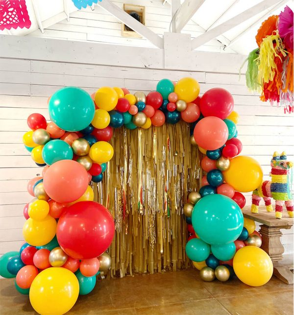 Gold Streamer photo backdrops with fiesta themed balloon display from Just Peachy in Little Rock, Arkansas.