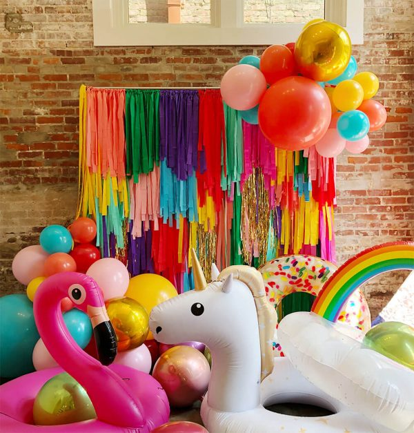 Multi-color streamer wall for photo backdrops and parties from Just Peachy.