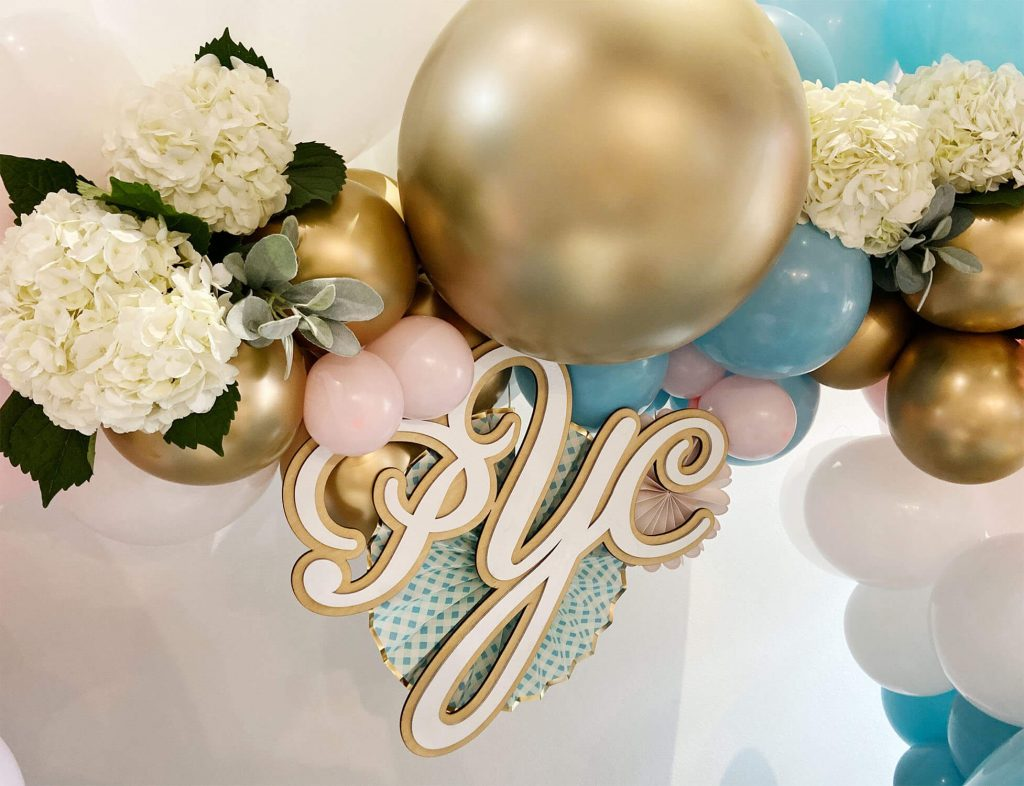 Custom wood monogram for a first birthday party with event planning by Just Peachy.