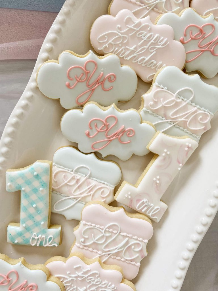 Custom monogram cookies for a boy and girl first birthday party with event planning by Just Peachy.
