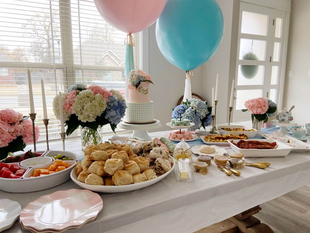 Breakfast table with pink and blue helium balloons and tassels by Just Peachy.